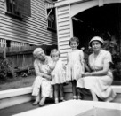Granma Halley, Carol Robyn and Mrs Sellars at the house front steps